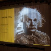 Einstein taking photo with iphone